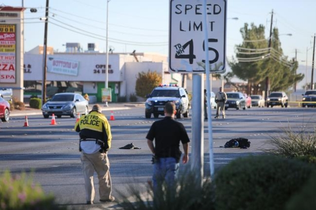 Police investigate a fatal accident in which a pedestrian was hit by a van on the 3200 block of East Desert Inn Road in Las Vegas on Friday, Nov. 20, 2015. Brett Le Blanc/Las Vegas Review Journal  ...