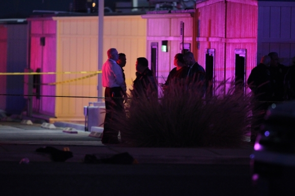 North Las Vegas police and Clark County School District police are on the scene at Mojave High School at 5302 Goldfield St. in North Las Vegas, where one person is dead after a shooting on Friday, ...