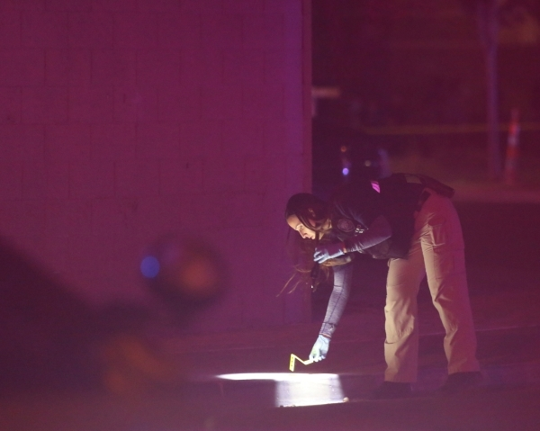 An investigator works at Mojave High School, 5302 Goldfield St. in North Las Vegas, where one person is dead after a shooting on Friday, Nov. 20, 2015. Brett Le Blanc/Las Vegas Review-Journal