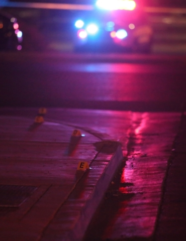 Markers are placed on a sidewalk as investigators work at Mojave High School, 5302 Goldfield St. in North Las Vegas, where one person is dead after a shooting on Friday, Nov. 20, 2015. Brett Le Bl ...