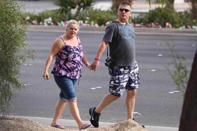 Tourists wearing shorts walk during a warm morning along Las Vegas Boulevard near the Mandalay Bay hotel-casino on Monday, Nov. 23, 2015.  Bizuayehu Tesfaye/Las Vegas Review-Journal Follow @bizute ...