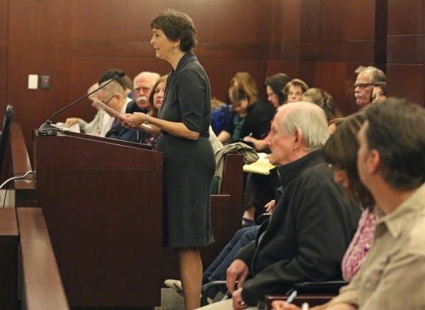 Terri Black, center, speaks about her father to a Supreme Court panel that addresses the Clark County guardianship system Monday, Nov. 23, 2015, at Regional Justice Center in Las Vegas. Ronda Chur ...