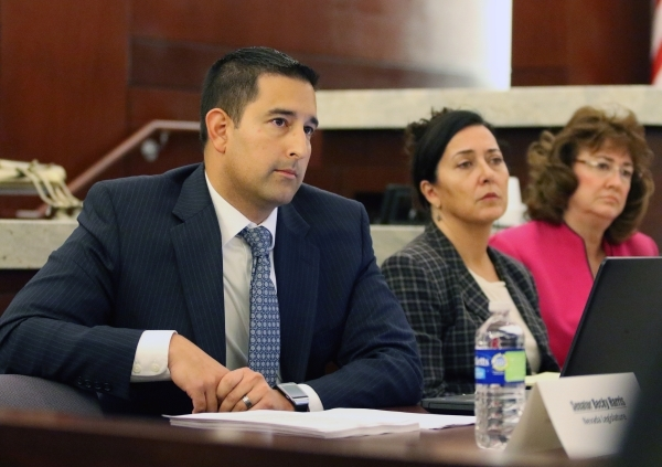 Clark County Chief Deputy District Attorney Jay Raman, left, sits on a Supreme Court panel to address the Clark County guardianship system Monday, Nov. 23, 2015, at Regional Justice Center in Las  ...