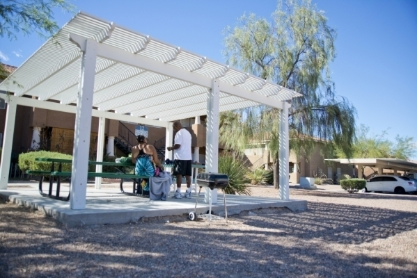 Tracy and Kenny Slaughter enjoy a shaded area outside at Lake Tonopah Apartments, a 356-unit complex near Martin Luther King and Lake Mead boulevards on Friday, Oct. 2, 2015. (Daniel Clark/Las Veg ...