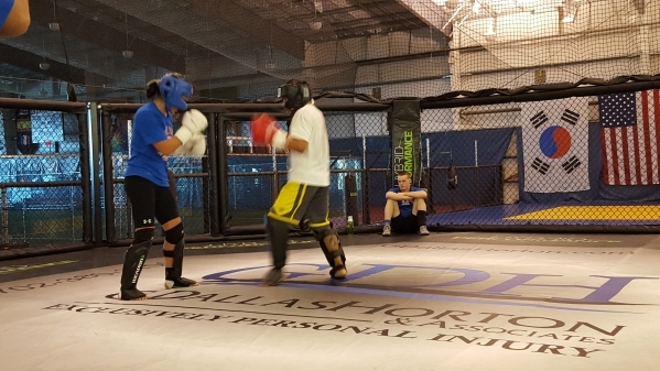 ONE Championship fighter Ana Julaton, left, goes through a sparring session Monday in Las Vegas as coach Ricky Lundell, rear, looks on on Monday, Nov. 23, 2015. Adam Hill/Las Vegas Review-Journal