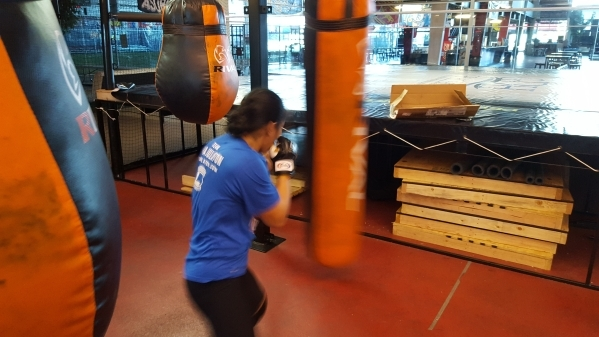 ONE Championship fighter Ana Julaton hits the heavy bag before a sparring session in Las Vegas on Monday. Nov. 23, 2015. Adam Hill/Las Vegas Review-Journal
