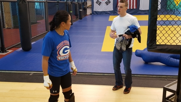 ONE Championship fighter Ana Julaton talks with coach Ricky Lundell after a sparring session in Las Vegas on Monday, Nov. 23, 2015. Adam Hill/Las Vegas Review-Journal