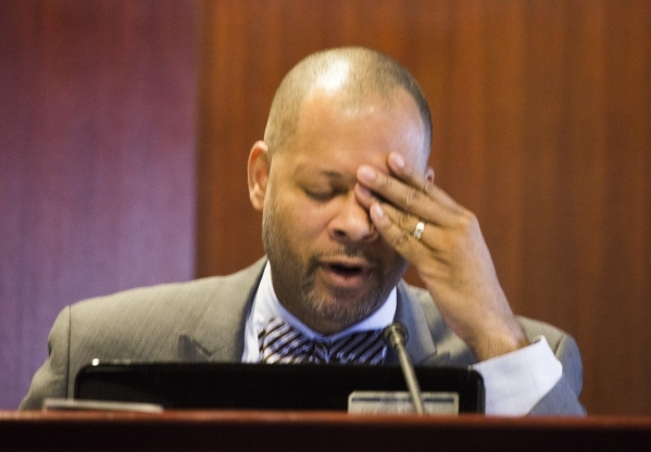 Sen. Aaron Ford (D-Las Vegas) rubs his eyes during the advisory committee hearing to develop a plan to reorganize the Clark County School District at the Grant Sawyer State Office Building on Mond ...