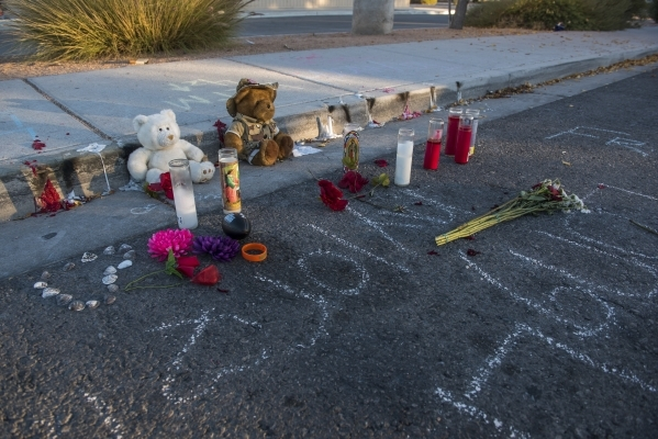 Messages and memorials to Taylor Brantley, a 16-year-old Mojave High School student killed near the school on Friday, line a curb near the school at 5302 Goldfield St. in North Las Vegas on Monday ...