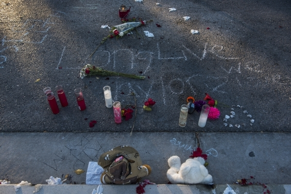 Candles and stuffed bears are placed in memory of Taylor Brantley, a 16-year-old Mojave High School student killed near the school on Friday, near the school at 5302 Goldfield St. in North Las Veg ...