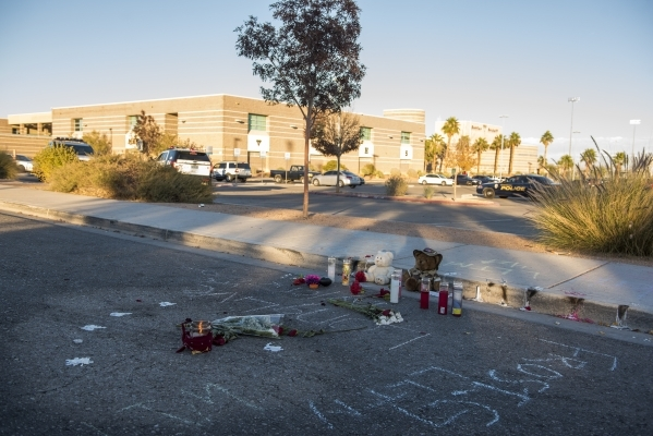 Memorials for Taylor Brantley, a 16-year-old Mojave High School student killed near the school on Friday, line a curb near the school at 5302 Goldfield St. in North Las Vegas on Monday, Nov. 23, 2 ...