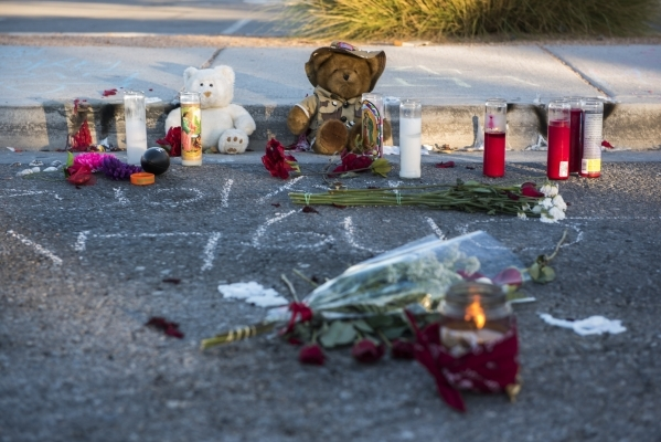 Memorials to Taylor Brantley, a 16-year-old Mojave High School student killed near the school on Friday, line a curb near the school at 5302 Goldfield St. in North Las Vegas on Monday, Nov. 23, 20 ...