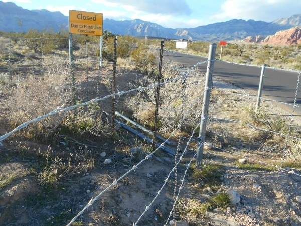 A closed sign is seen at the entrance to the Red Rock Canyon National Conservation Area 13-mile Scenic Drive and visitor center Wednesday, Nov. 25, 2015. The visitor center was closed at 8 a.m. du ...