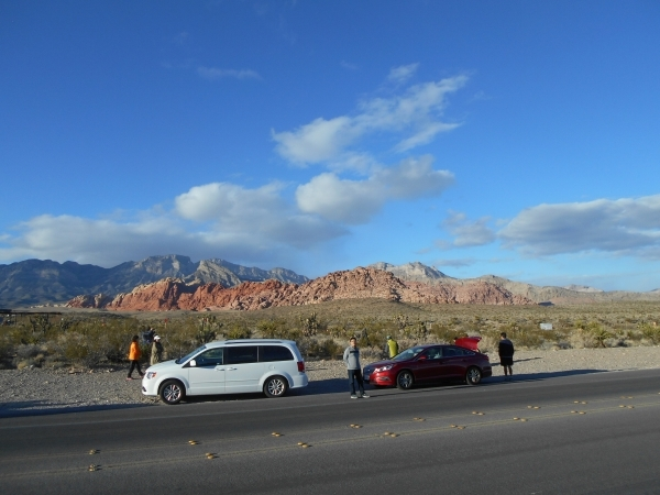 People wait near the closed entrance to the Red Rock Canyon National Conservation Area 13-mile Scenic Drive and visitor center Wednesday, Nov. 25, 2015. The visitor center was closed at 8 a.m. due ...