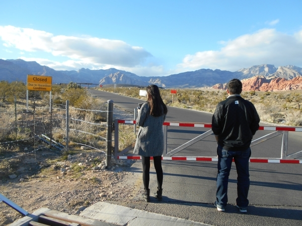 People wait at the closed entrance to the Red Rock Canyon National Conservation Area 13-mile Scenic Drive and visitor center Wednesday, Nov. 25, 2015. The visitor center was closed at 8 a.m. due t ...