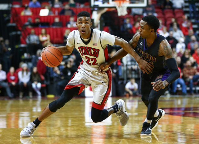 UNLV guard Patrick McCaw (22) drives past Prairie View A&M's Ja'Donta Blakely (25) during a basketball game at the Thomas & Mack Center in Las Vegas on Saturday, Nov. 28, 2015. ...