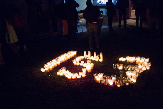 Candles are lit in the shape of the number 153, an estimate of people killed in the terror attacks in Paris. Secular groups organized the vigil at The Slammer in Las Vegas. (Ricardo Torres/Las Veg ...
