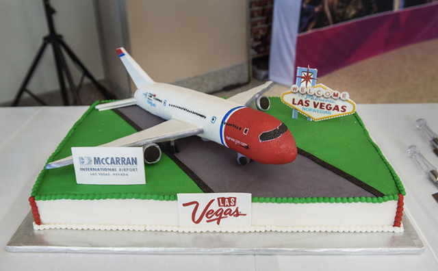 A special cake celebrates the welcome of  Norwegian Air's first flight from Copenhagen, Denmark on Tuesday, Nov. 10, 2015 at McCarran International Airport in Las Vegas. In addition to its d ...