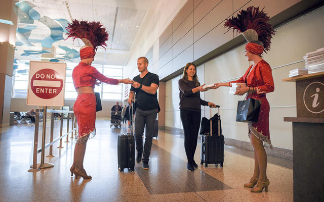 Showgirls offer gifts to passengers as McCarran International Airport and the Las Vegas Convention and Visitors Authority welcome Norwegian Air's first flight from Copenhagen, Denmark on Tue ...