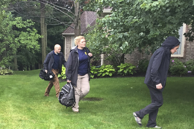 FBI investigators search the house of Subway sandwich chain pitchman Jared Fogle in Zionsville, Indiana in this July 7, 2015 file photo. Former Subway sandwich chain pitchman Jared Fogle is expect ...