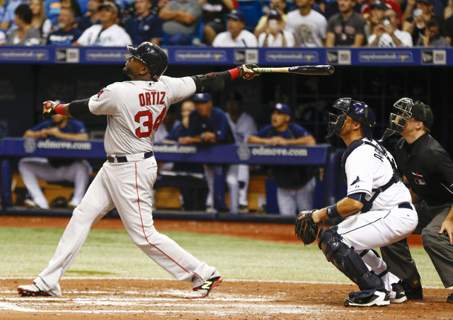 Sep 12, 2015; St. Petersburg, FL, USA; Boston Red Sox designated hitter David Ortiz (34) hits a fly ball to center for an out in his second at bat as Tampa Bay Rays catcher J.P. Arencibia (40) and ...
