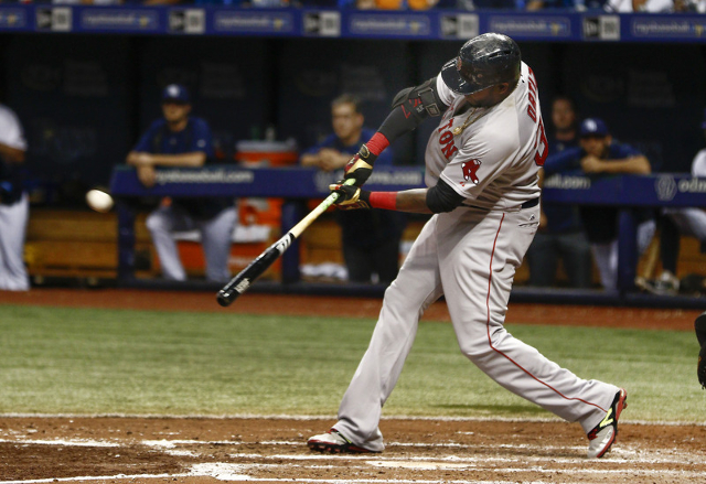 Sep 12, 2015; St. Petersburg, FL, USA; Boston Red Sox designated hitter David Ortiz (34) hits his 500th home run during the fifth inning of a baseball game against the Tampa Bay Rays at Tropicana  ...