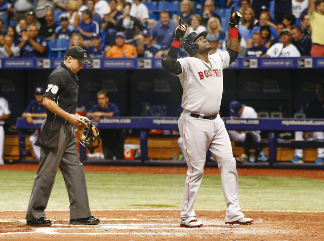 Sep 12, 2015; St. Petersburg, FL, USA; Boston Red Sox designated hitter David Ortiz (34) celebrates as umpire Adam Hamari looks on after Ortiz hits his 500th home run during the fifth inning of a  ...
