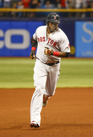 Sep 12, 2015; St. Petersburg, FL, USA; Boston Red Sox designated hitter David Ortiz (34) rounds third base after he hits his 500th home run during the fifth inning of a baseball game against the T ...