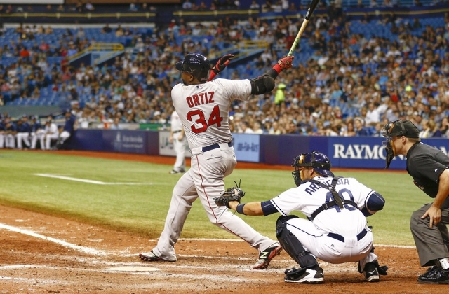 Sep 12, 2015; St. Petersburg, FL, USA; Boston Red Sox designated hitter David Ortiz (34) hits a single to center during the seventh inning of a baseball game against the Tampa Bay Rays at Tropican ...