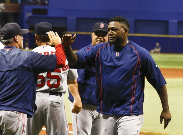Sep 12, 2015; St. Petersburg, FL, USA; Boston Red Sox designated hitter David Ortiz (34) congratulates his teammates following a baseball game against the Tampa Bay Rays where he reached the 500 h ...
