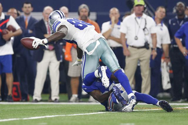 Sep 13, 2015; Arlington, TX, USA; Dallas Cowboys receiver Dez Bryant (88) dives for extra yards in the fourth quarter against New York Giants cornerback Prince Amukamara (20) at AT&T Stadium.  ...