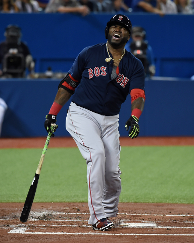Sep 18, 2015; Toronto, Ontario, CAN; Boston Red Sox designated hitter David Ortiz (34) reacts after fouling a ball off his foot against Toronto Blue Jays in the second inning at Rogers Centre. (Da ...