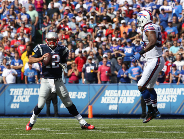 Buffalo Bills defensive end Mario Williams (94) watches as New England Patriots quarterback Tom Brady (12) looks to make a pass during the first half at Ralph Wilson Stadium in Orchard Park, N.Y., ...