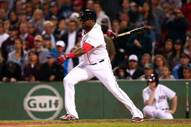 Sep 21, 2015; Boston, MA, USA; Boston Red Sox designated hitter David Ortiz (34) knocks in a run against the Tampa Bay Rays during the seventh inning at Fenway Park. (Mark L. Baer/USA Today Sports)
