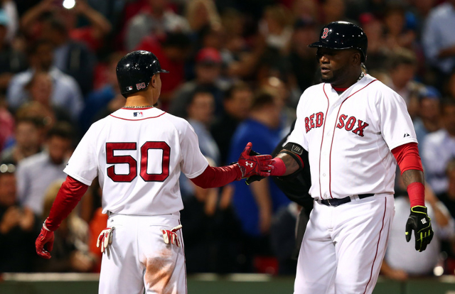 Sep 24, 2015; Boston, MA, USA; Boston Red Sox designated hitter David Ortiz (R) celebrates his home run against the Tampa Bay Rays with center fielder Mookie Betts (50) during the first inning at  ...