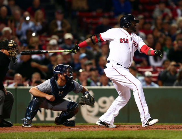 Sep 24, 2015; Boston, MA, USA; Boston Red Sox designated hitter David Ortiz (34) hits a home run against the Tampa Bay Rays during the first inning at Fenway Park. (Mark L. Baer/USA Today Sports)