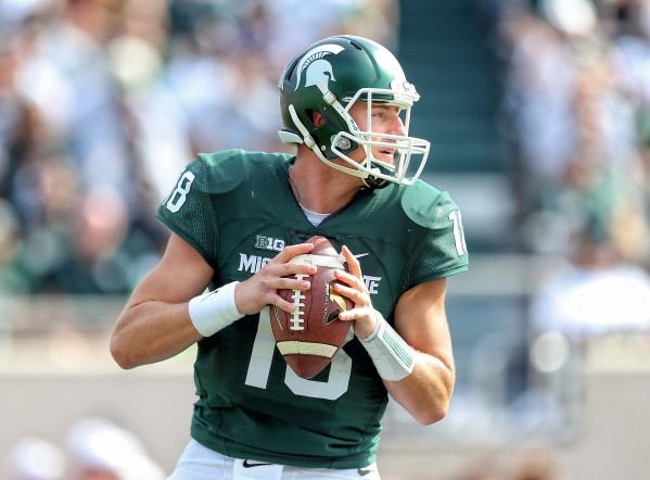 Sep 26, 2015; East Lansing, MI, USA; Michigan State Spartans quarterback Connor Cook (18) drops back to pass the ball during the 1st quarter of a game against Central Michigan at Spartan Stadium.  ...