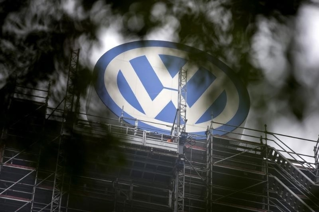 A Volkswagen logo stands on the roof of the company's headquarters in Wolfsburg, Germany October 7, 2015. (Axel Schmidt/Reuters)