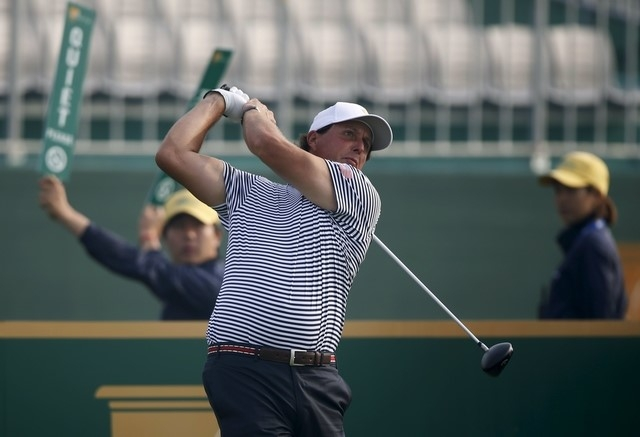 Phil Mickelson tees off on the first hole during the practice round for the 2015 Presidents Cup at the Jack Nicklaus Golf Club in Incheon, South Korea, October 7, 2015. (REUTERS/Kim Hong-Ji)