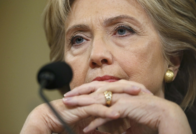Democratic presidential candidate Hillary Clinton appears before the House Select Committee on Benghazi on Capitol Hill in Washington October 22, 2015. The congressional committee is investigating ...