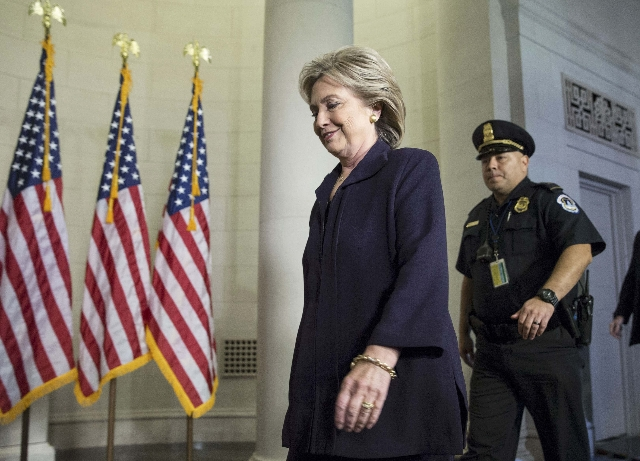 U.S. Democratic presidential candidate Hillary Clinton arrives to testify before the House Select Committee on Benghazi on Capitol Hill in Washington October 22, 2015. The congressional committee  ...