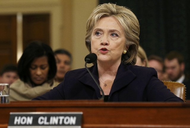 U.S. Democratic presidential candidate Hillary Clinton testifies before the House Select Committee on Benghazi on Capitol Hill in Washington October 22, 2015. The congressional committee is invest ...
