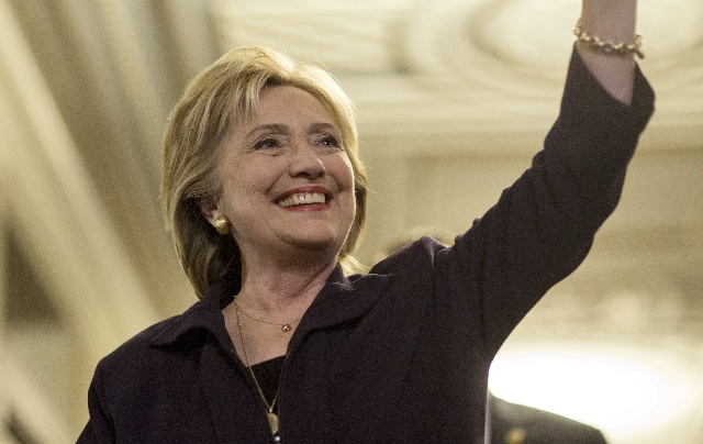 U.S. Democratic presidential candidate Hillary Clinton waves after testifying to the House Select Committee on Benghazi on Capitol Hill in Washington October 22, 2015. Clinton deflected harsh Repu ...