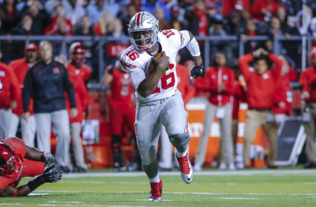 Oct 24, 2015; Piscataway, NJ, USA; Ohio State Buckeyes quarterback J.T. Barrett (16) turns up field during the first quarter against the Rutgers Scarlet Knights at High Points Solutions Stadium. ( ...
