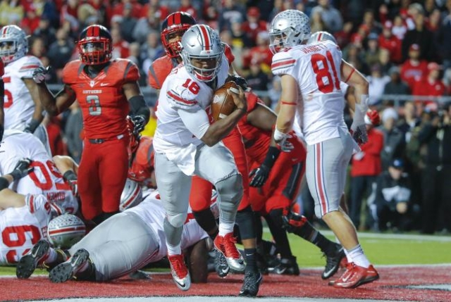 Oct 24, 2015; Piscataway, NJ, USA; Ohio State Buckeyes quarterback J.T. Barrett (16) crosses the goal line for second quarter touchdown against the Rutgers Scarlet Knights at High Points Solutions ...