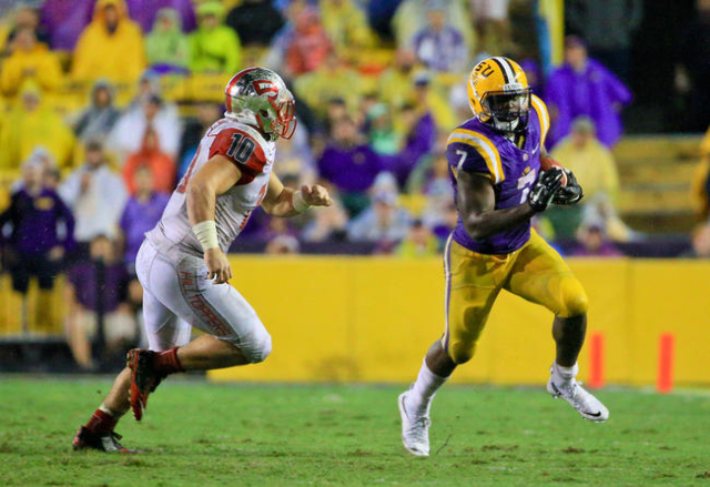Oct 24, 2015; Baton Rouge, LA, USA; LSU Tigers running back Leonard Fournette (7) runs from Western Kentucky Hilltoppers linebacker Nick Holt (10) during the fourth quarter of a game at Tiger Stad ...
