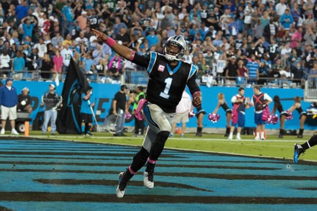 Oct 25, 2015; Charlotte, NC, USA; Carolina Panthers quarterback Cam Newton (1) celebrates after a touchdown during the third quarter against the Philadelphia Eagles at Bank of America Stadium. Car ...
