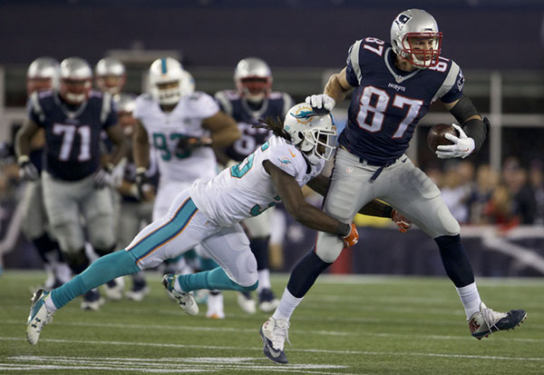 Oct 29, 2015; Foxborough, MA, USA; New England Patriots tight end Rob Gronkowski (87) runs the ball against Miami Dolphins free safety Walt Aikens (35) in the second half at Gillette Stadium. The  ...