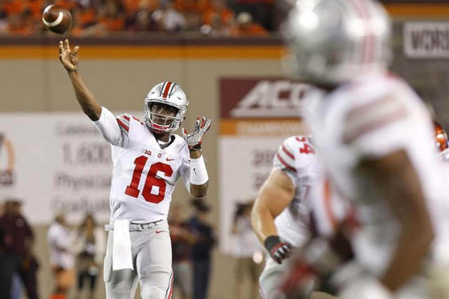 Ohio State Buckeyes quarterback J.T. Barrett (16) throws a touchdown pass to Buckeyes wide receiver Michael Thomas (3) in the fourth quarter at Lane Stadium. The Buckeyes won 42-24. Mandatory Cred ...