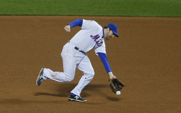 Oct 31, 2015; New York City, NY, USA; New York Mets second baseman Daniel Murphy commits a fielding error on a ball hit by Kansas City Royals first baseman Eric Hosmer (not pictured) in the 8th in ...